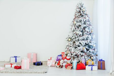 happy holidays Christmas new year tree gifts Interior white room