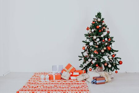 Christmas tree with presents of toys with a Garland of new year winter Stock Photo