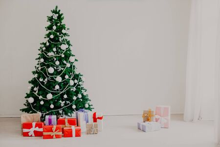 Green Christmas tree with toys new year 2019 winter gifts decor