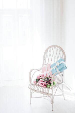 vintage chair with gifts in the interior of the room