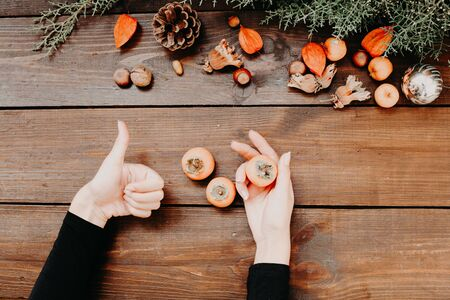 Christmas cones fruits nuts women hands Christmas background
