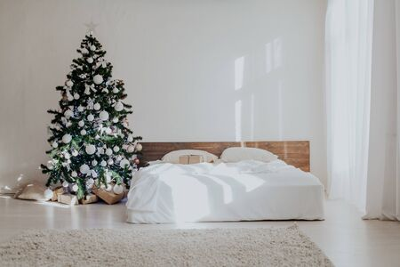 bedroom with rozhdetvenskim new year tree decoration bed