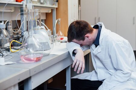 scientist sleeps workplace chemical experiments with fluids in medical lab