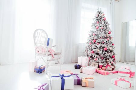 Christmas Tree presents holiday winter interior background Stock Photo