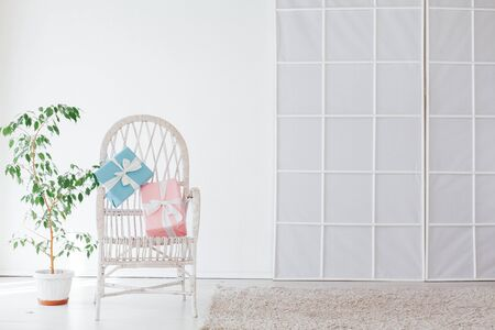 chair with gifts in the interior of the white room of the house Stock Photo