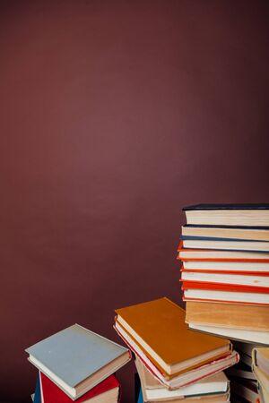 stacks of educational books university library background