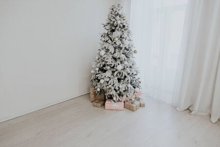 Christmas tree with presents, Garland lights Interior new year winter holiday