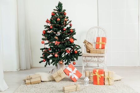 Christmas tree with presents in the room with a winter decoration f
