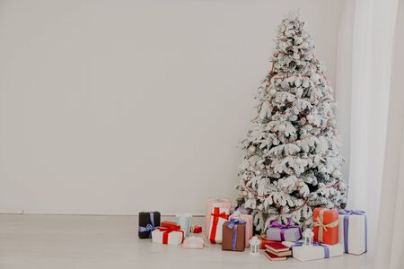 Christmas tree with presents, Garland lights new year 2020