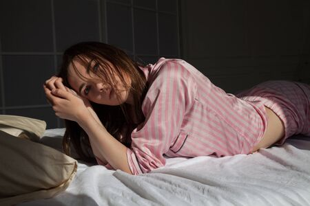 woman in underwear in the morning in the sleep on the bed
