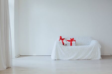 sofa with festive gifts in the interior of new year Christmas