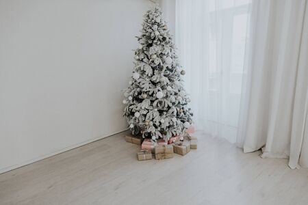 Christmas tree with gifts of the new year home