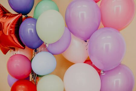 balloons of different colors with gifts for the holiday 1