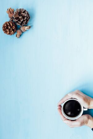 a cup of tea in hand Christmas background tree new year gifts