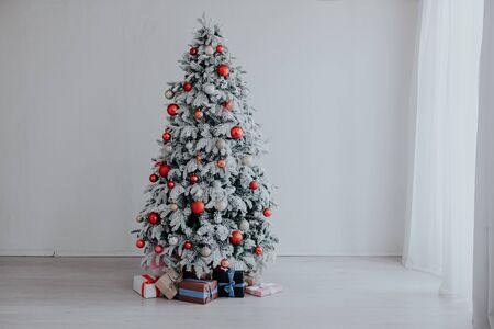 Merry Christmas gifts Interior white room new year tree