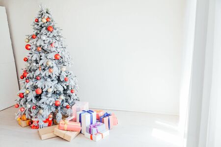 Christmas Christmas tree with presents in a white room Stok Fotoğraf