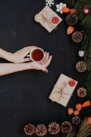 Christmas new year female hands holding Cup of tea