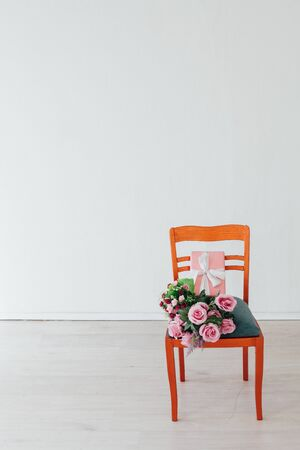 one chair with flowers in the interior of a white empty room 写真素材