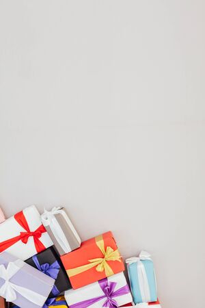 lots of colorful gifts on a gray background Stock fotó