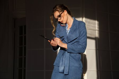 portrait of a beautiful fashionable woman in a business suit in the office at work Stock fotó