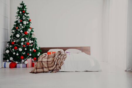 Christmas new year tree Interior bedroom and bed with gifts