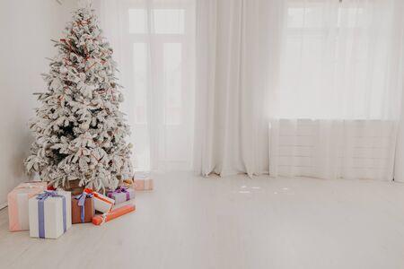 Christmas tree decor Interior white room new year holidays Reklamní fotografie