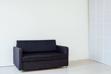black sofa in the interior of the room