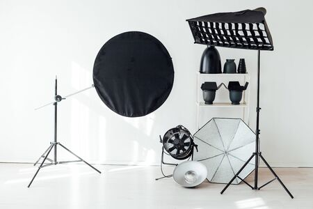 Photo studio flash equipment and accessories of a professional photographer