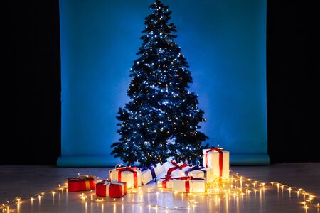 Christmas tree with lights garlands decor of the house new year
