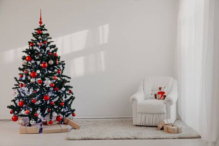 Christmas tree in a white room for Christmas with gifts