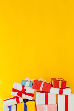 Christmas presents on a yellow background