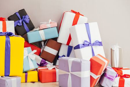 multicolored Christmas birthday presents on a grey background