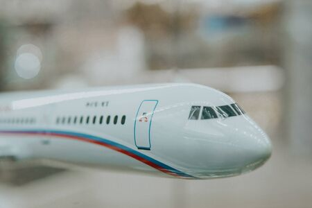 white passenger plane with russian flag toy airport Imagens