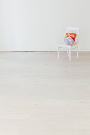 chair with birthday present in the interior of the white room