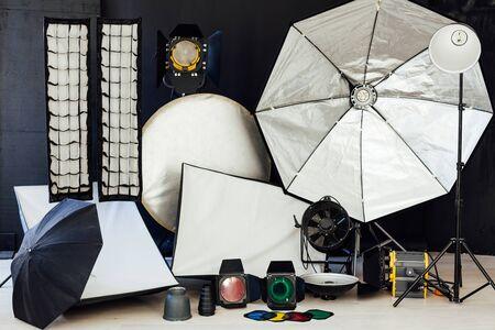 Photo studio equipment flash accessories on black background