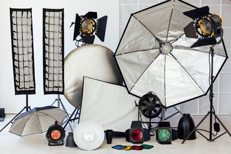 Photo studio equipment flash accessories on a white background