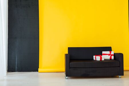 black sofa with gifts in the interer of the house Stock Photo