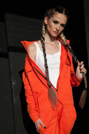portrait of a beautiful woman in an orange jumpsuit Archivio Fotografico