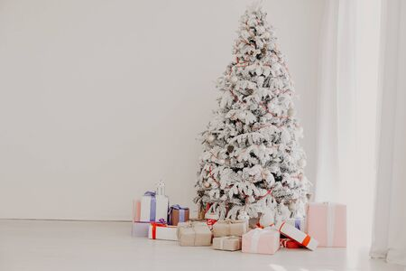 White Christmas tree in Konate with stocking-stuffers 1 Stock Photo