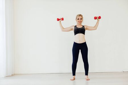 Female athlete engaged in fitness with dumbbells sport Reklamní fotografie