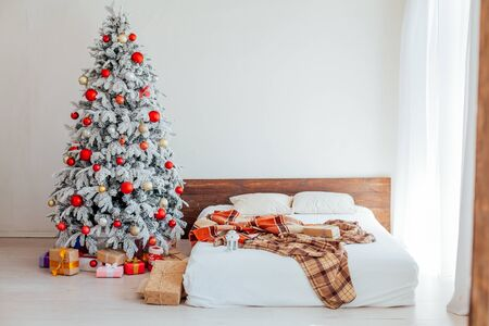 Christmas tree in the master bedroom bed holiday gifts new year White House decor
