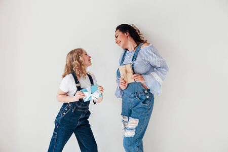 beautiful woman and daughter with gifts in a denim Stock fotó