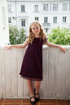 Portrait of a beautiful girl 10 years old in a dark dress