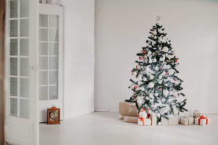 room decorated for Christmas Christmas tree gifts