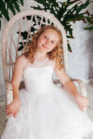 Beautiful fashionable girl 10 years old in a white dress Stock Photo