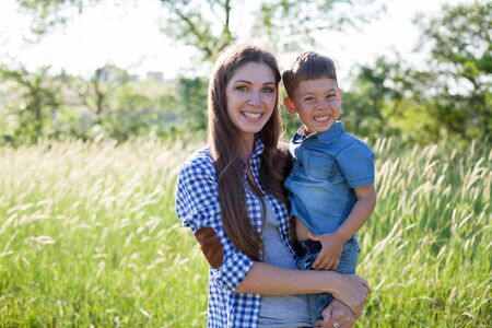 Portrait of a beautiful woman with her son on a walk in nature Stock fotó