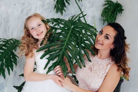 Portrait of a beautiful fashionable mom and daughters family love Stock fotó