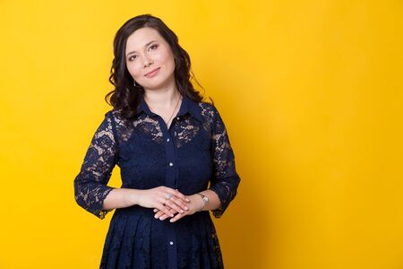 Portrait of a beautiful Asian woman in a blue dress