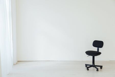 black office chair to work in the interior of the white room