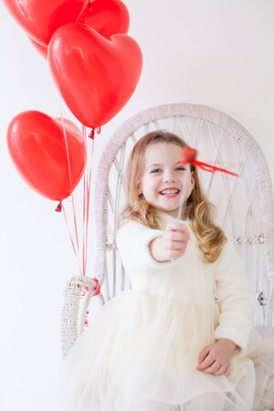 girl with red balloons for the holiday Stockfoto